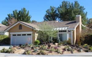 House front with desert landscaping