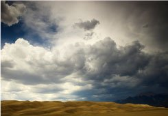 Dark stormy clouds over desert